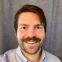 Headshot of article author Dustin Askins