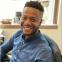 Headshot of article author Ogbemi Ekwejunor-Etchie