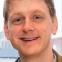 Headshot of article author Patrick Baumgartner