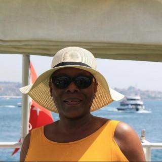 Ms. Funmi Ade. MPhil, MSc, BA (Hons), FIC, MCIPS, CPPM, D7307.